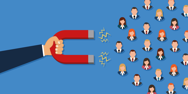 Mão segurando imã para captação de leads - Inbound Marketing